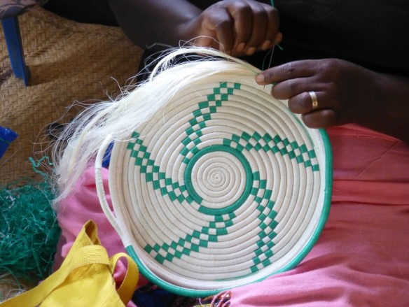 Refugee woman making basket from sisal plant.